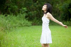 Beautiful Asian girl laughing outdoors Stock Photos