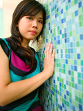 Beautiful Asian Girl Lean Blue Wall Royalty Free Stock Photos