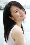 Beautiful Asian girl looking at viewer Stock Photos