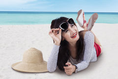 Beautiful asian girl lying on beach Royalty Free Stock Photos