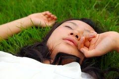 Beautiful Asian girl lying down Royalty Free Stock Image