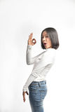 Beautiful asian girl making OK sign Royalty Free Stock Photos