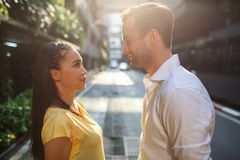 Beautiful asian girl and man together on the street royalty free stock photos