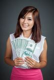 Beautiful Asian girl with many100 dollar bills Royalty Free Stock Images