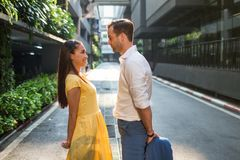 Beautiful asian girl and man together on the street stock photos