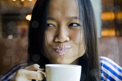 Beautiful Asian girl with milk on lips Stock Photography