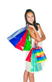 The beautiful Asian girl  with packages Royalty Free Stock Photo