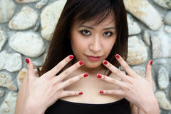 Beautiful Asian girl with painted nails Royalty Free Stock Photography