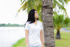 Beautiful Asian girl in the park. And looking up to the sky Stock Images
