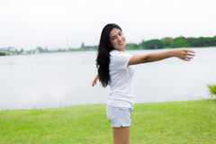 Beautiful Asian girl in the park. Beautiful young asian woman exercising in the park Stock Photography