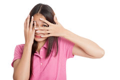 Beautiful Asian girl peeking through fingers. Isolated on white background Stock Images