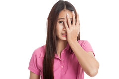 Beautiful Asian girl peeking through fingers Stock Images