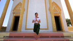 Beautiful Asian Girl performs cambodian folk dance in temple stock footage