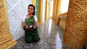 Beautiful Asian Girl performs coconut folk dance in temple Stock Photos