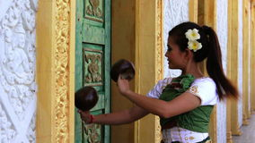 Beautiful Asian Girl performs coconut folk dance in temple Stock Images