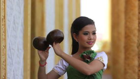 Beautiful Asian Girl performs coconut folk dance in temple Stock Photography