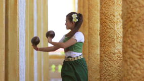 Beautiful Asian Girl performs coconut folk dance in temple Royalty Free Stock Photography
