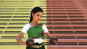 Beautiful Asian Girl performs coconut folk dance in temple Royalty Free Stock Images