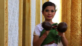 Beautiful Asian Girl performs coconut folk dance in temple Royalty Free Stock Image
