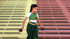 Beautiful Asian Girl performs coconut folk dance in temple Royalty Free Stock Photos