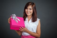 Beautiful Asian girl with a pink gift box Royalty Free Stock Photos