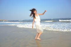 Beautiful Asian girl playing in the seaside Royalty Free Stock Photos