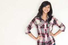 Beautiful asian girl posing and staring to the camera. Girl with red black and white casual shirt posing Stock Photos