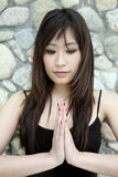 Beautiful Asian girl praying Royalty Free Stock Images