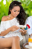 Beautiful Asian girl reading book Stock Photography