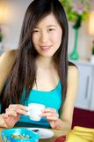 Beautiful asian girl ready to go to work after healthy breakfast Royalty Free Stock Photography