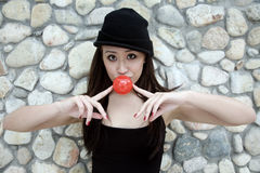 Beautiful Asian girl with a red ball Royalty Free Stock Photo