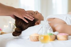 Beautiful Asian girl relaxing receiving facial massage in a spa. Salon royalty free stock photos