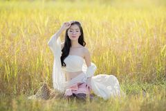 Beautiful asian girl  in the rice field. Beautiful asian girl wear a Thai traditional dress in the rice field Royalty Free Stock Images