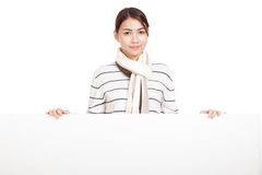 Beautiful Asian girl with scarf and blank sign Royalty Free Stock Photo