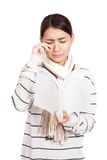 Beautiful Asian girl with scarf crying read a book Stock Photos