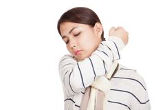 Beautiful Asian girl with scarf got back pain Royalty Free Stock Photography
