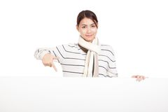 Beautiful Asian girl with scarf point to blank sign Stock Photography