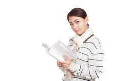 Beautiful Asian girl with scarf  read a book Stock Photo
