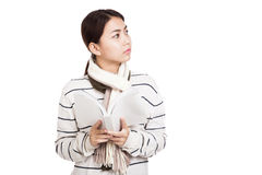 Beautiful Asian girl with scarf  read a book look away Royalty Free Stock Images