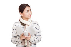 Beautiful Asian girl with scarf  read a book look away and smile Stock Image