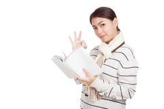 Beautiful Asian girl with scarf  read a book show OK sign Stock Photography