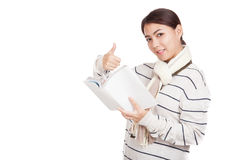 Beautiful Asian girl with scarf  read a book show thumbs up Royalty Free Stock Image