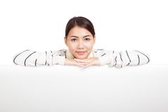 Beautiful Asian girl with scarf rest her chin on  blank sign Royalty Free Stock Photo