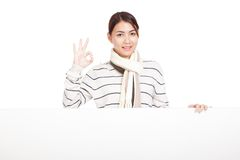Beautiful Asian girl show OK with scarf and blank sign Royalty Free Stock Photography