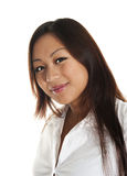 Beautiful asian girl smiling. Seen against white background Royalty Free Stock Photos