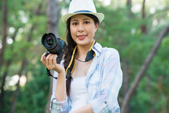 Beautiful asian girl smiling with digital camera photographing, Stock Image