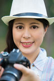 Beautiful asian girl smiling with digital camera photographing, Royalty Free Stock Image