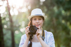 Beautiful asian girl smiling with digital camera photographing, Stock Photo