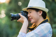 Beautiful asian girl smiling with digital camera photographing, Stock Photos