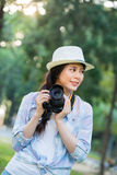Beautiful asian girl smiling with digital camera photographing, Royalty Free Stock Photography